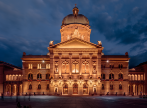 1200px-Federal Palace of Switzerland during Blue Hour